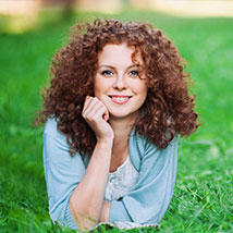 woman with curly hair smling