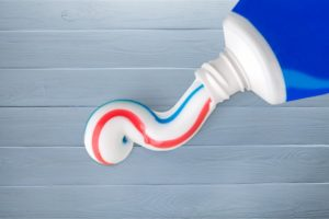 toothpaste container red blue white